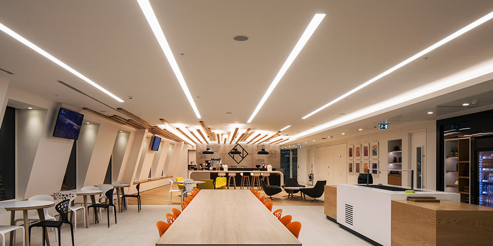 Bespoke circus pendant was adapted to provide the required aesthetic the design called for a series of ring pendants with direct and indirect lighting